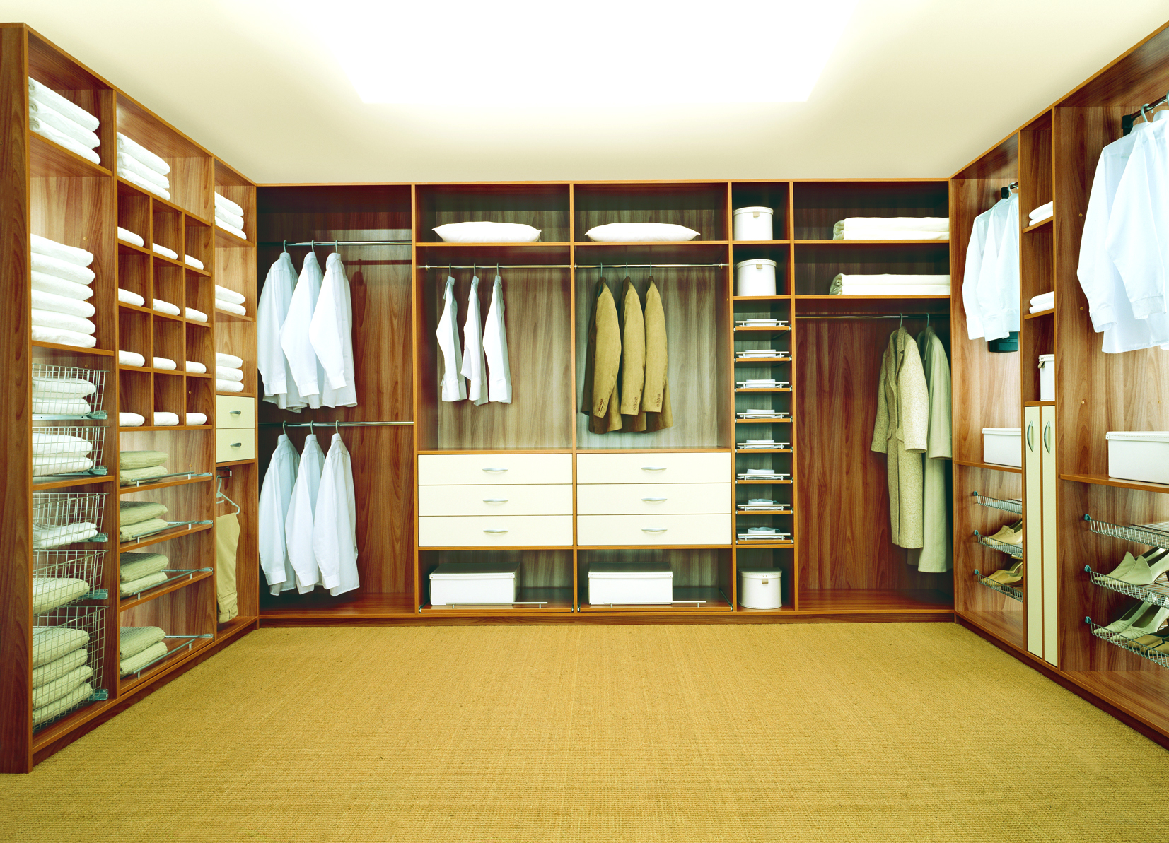 Walk in closet or dressing room with shelves and drawers all made to